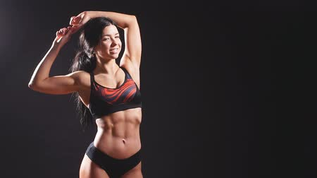 perfetto : Portrait of young beautiful fitness woman ,isolated on black background. Slow motion