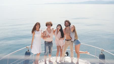 youngsters : Marine cruise and vacation - youngsters with champagne glasses on boat or yacht