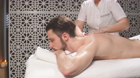 shiatsu : Young male getting massage for arms in the modern resort