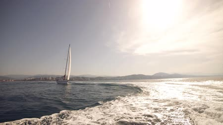 yatçılık : Sail boat during sunny summer weather on calm blue sea water with romantic couple on the deck. Luxury summer adventure, active vacation in Mediterranean sea.