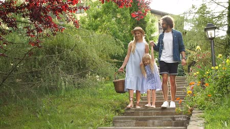 rodzeństwo : Beautiful caucasian family with daughter down the stairs, walking on picnic