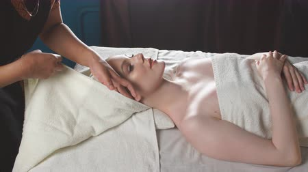 rejuvenescimento : Adult european wealthy woman getting anti-aging face-lifting massage relaxing after working day.