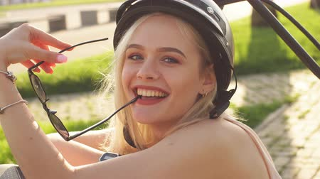 байкер : Woman wearing biking helmet looking at camera. Close-up portrait of female cyclist. Стоковые видеозаписи