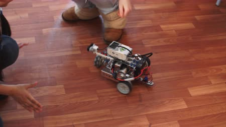 keşif : Learning process in robotics school. Curious kid playing with self made robot managed from the constructor, child learns robot constructing.