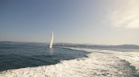 yatçılık : Amazing Seascape with White Sailing Boat in Blue Sea. Stok Video