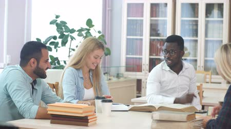reference : Diverse multiethnic young business partners working on new project, making investigations in old history books. Occupation, Library, Books, International Friend Concept Stock Footage