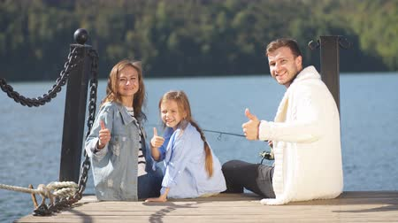 affluent : Family with daughter spending time together on sailboat