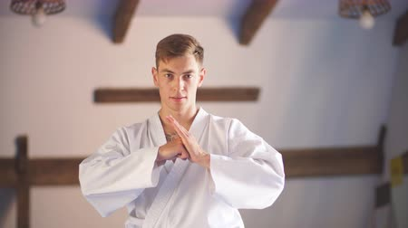 wąsy : Closeup of karate hands. Over martial arts gym