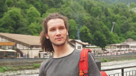 harcerz : Man Traveler with red backpack hiking outdoor. Travel, Lifestyle, vacation and Adventure concept