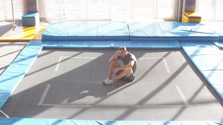akt : Young active sportsman resting on the floor after the competition. Dostupné videozáznamy