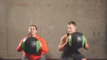xxl : Emotional positive couple doing exercises with balls in the fitness center. active life