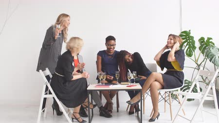 giymek : Female confidence and cheerful leadership from african american woman in group meeting of small business partners, multi level marketing concept