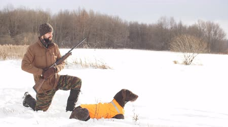 fince : awesome young man with his dog during the hunting. side view shot. hobby, lifestyle