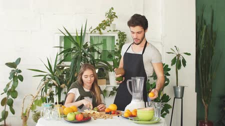 kitchen blender : Attractive cheerful people are making milkshake. meal replacement
