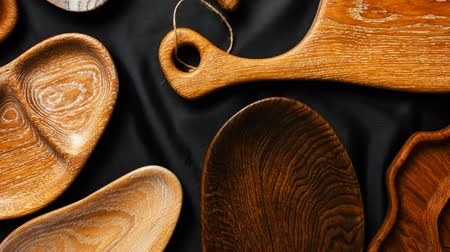 ware : Rich variety of wooden empty cutting boards and plates on dark background. Mock up of dishes for restaurant serving