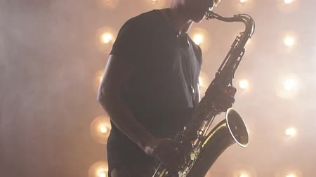 jazzman : Emotional musician with sax during the concert. Enjoyment. people, star concept Stock Footage