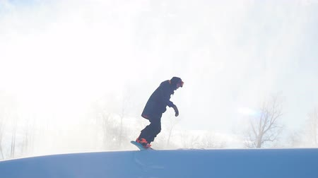 szermierka : amateur sport. first effort during skateboarding. wrong techniquein snowboarding. man with a snowboard is clumbing to the mountaint