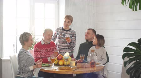 érték : Family celebrating New Year. Christmas time. Care, feeling, family ties. Value tradition customs Stock mozgókép