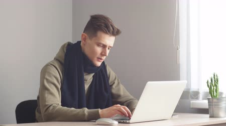 szekrény : Attractive office worker working hard at his cabinet, programming something on his computer. Workaholic, freelance position, making money.