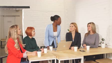 опытный : Glad cheerful businesswoman, boss of business team congratulates her co-workers in meeting room, celebrating the performance of new product Стоковые видеозаписи
