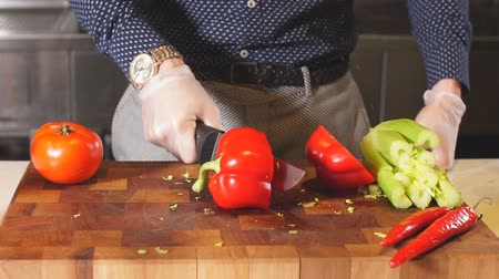 tome : Man cutting a red pepper for dish, fresh vegetables, vitamin, process of preparing creative meal Stock Footage