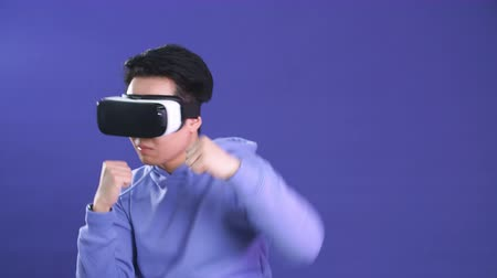 mounted : Future is right now. Young Man using 3D virtual reality headset. Virtual reality game. Man with pleasure uses head-mounted display. Young man playing game in virtual reality glasses.