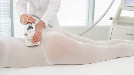 legs only : LPG skin massage in professional beauty studio. Midsection sot of womans body receiving LPG skin care. Hardware technology, Weightloss, Anti Cellular Therapy, Bodycare Stock Footage