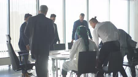 busy line : Joyful group of diverse multiracial businessmen on corporate training session fulfil test task of a coach, having fun over panoramic windows background. Stock Footage