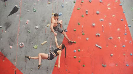 rota : Happy athletes performing dangreous movements while climbing. Lifestyle , happiness,