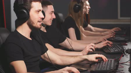 esports : Young gamers playing video game while spending weekend at pc gaming club.