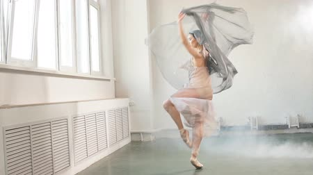 balerína : Young ballerina with a perfect body is dancing in the studio. Ballet dancer dressed in scenic dress, colorful costume emphasizes the plasticity of their movements.