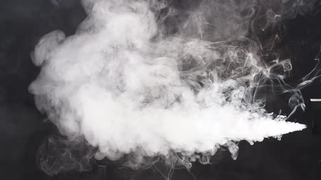 példa : Stream of white smoke on an isolated black studio background, slow motion.