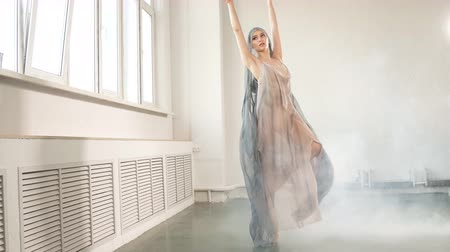 white cloths : Modern ballet dancer in scenic flowing costume working out at studio during final reheasal . Art concept. Inspiration. Stock Footage