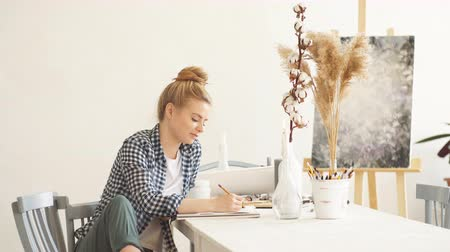 awesome : Awesome positive blond woman enjoying drawing at home, happiness, pastime, job, profession