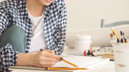 um : Awesome positive blond woman enjoying drawing at home, happiness, pastime, job, profession