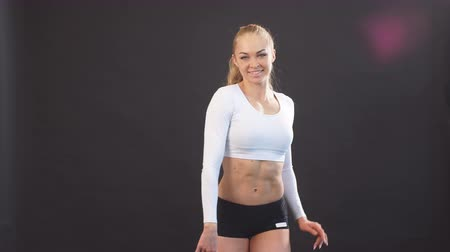 sports nutrition : Young beautiful blonde woman in stylish fitness clothing posing to the camera. Hobby, free time, body care