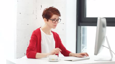 computer programmer : Young business woman working online shopping at her office