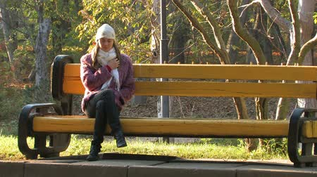 feminity : Beautifull young Woman sitting on bench on a sunny day