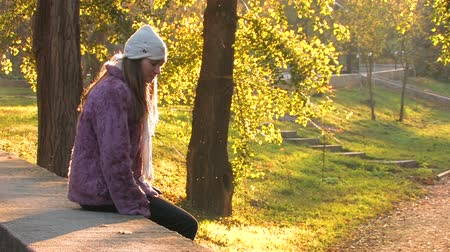 feminity : Pretty young Woman in Park on autumn sunny day Stock Footage