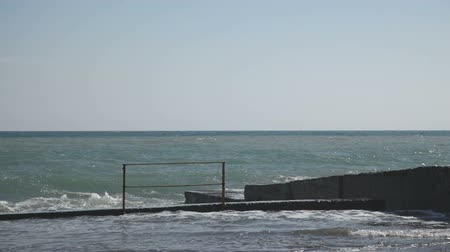 groyne : Embankment and pier with huge waves