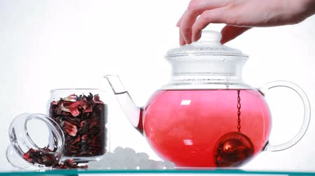 hibiscus tea : Woman preparing red Hibiscus tea Stock Footage
