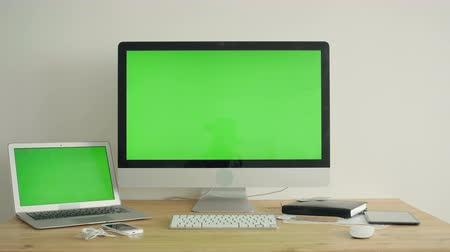 replaceable : PC Display With Green Screen On The Table