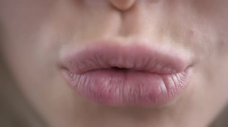 закрывать : Extreme Close Up of Womans Sexy Lips with Botox