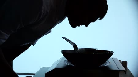 mutfak malzemesi : Chef Silhouette Roasting Vegetables In a Wok