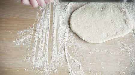 hamur : Girl Rolls Out The Pizza Dough With The Rolling Pin