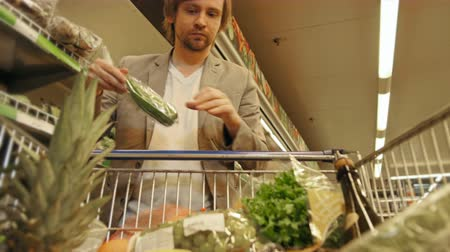 legjobb : Handsome Man Shopping In A Supermarket, View From Shopping Trolley Stock mozgókép