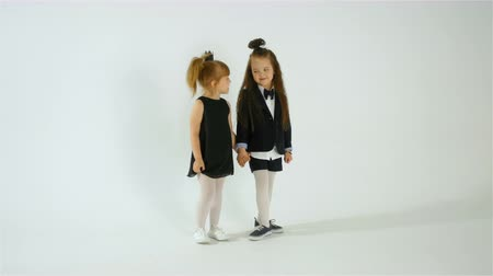 preschool : Two Shy Preschool Girls Posing On Camera, Kid Fun Concept, Isolated On White Stock Footage