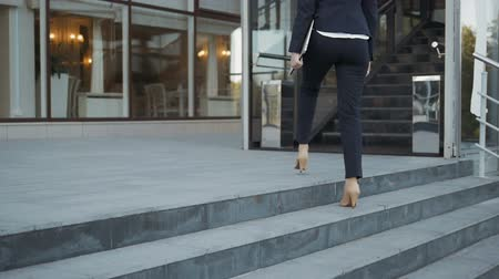 schody : Businesswoman Legs In High-Heeled Shoes Walking Up Stairs On Stairway