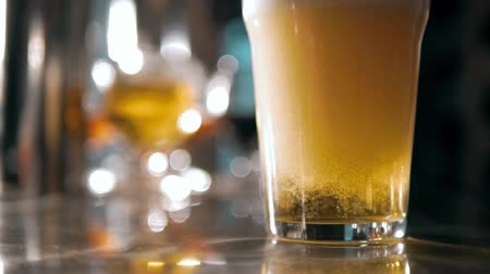craft beer : Beer into glass with a lot of bubles and foam super close up slow motion.