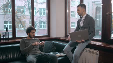boss : Young businessman explaining data to colleague at meeting, two freelancers work late